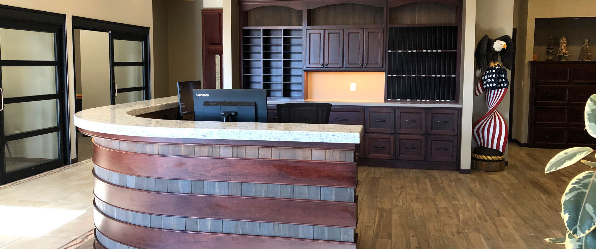 Custom wood receiption desk and storage cabinets designed, built, and installed by finewood Structures of Browerville, MN