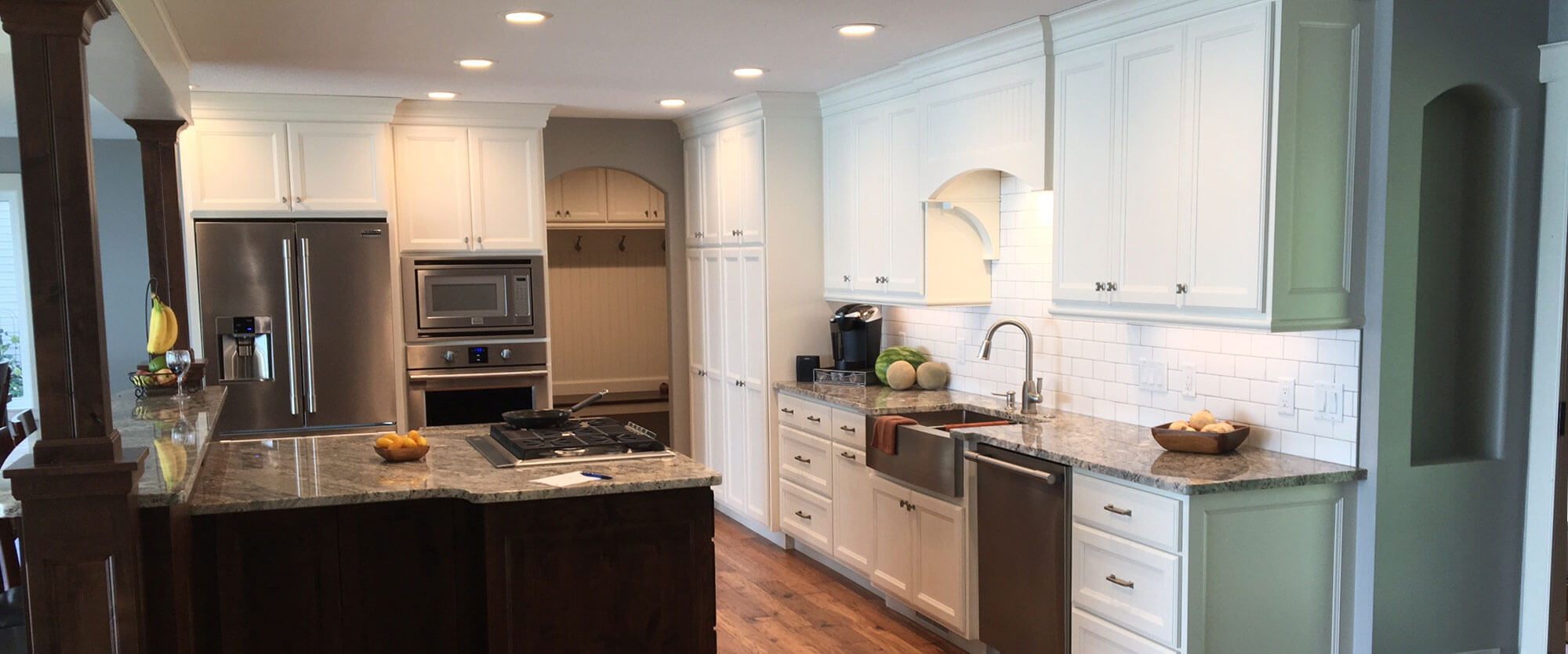Custom kitchen cabinets made of solid wood and painted white; designed, built, and installed by finewood Structures of Browerville, MN