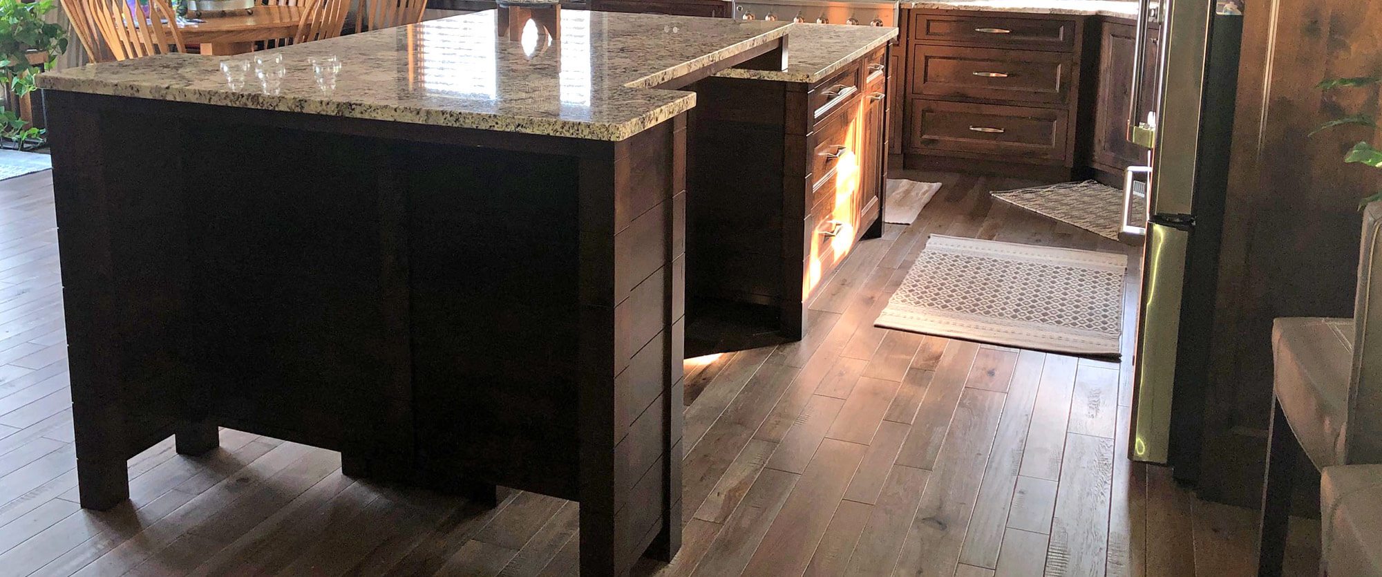 Oversized custom kitchen island made of Alder; designed, built, and installed by finewood Structures of Browerville, MN