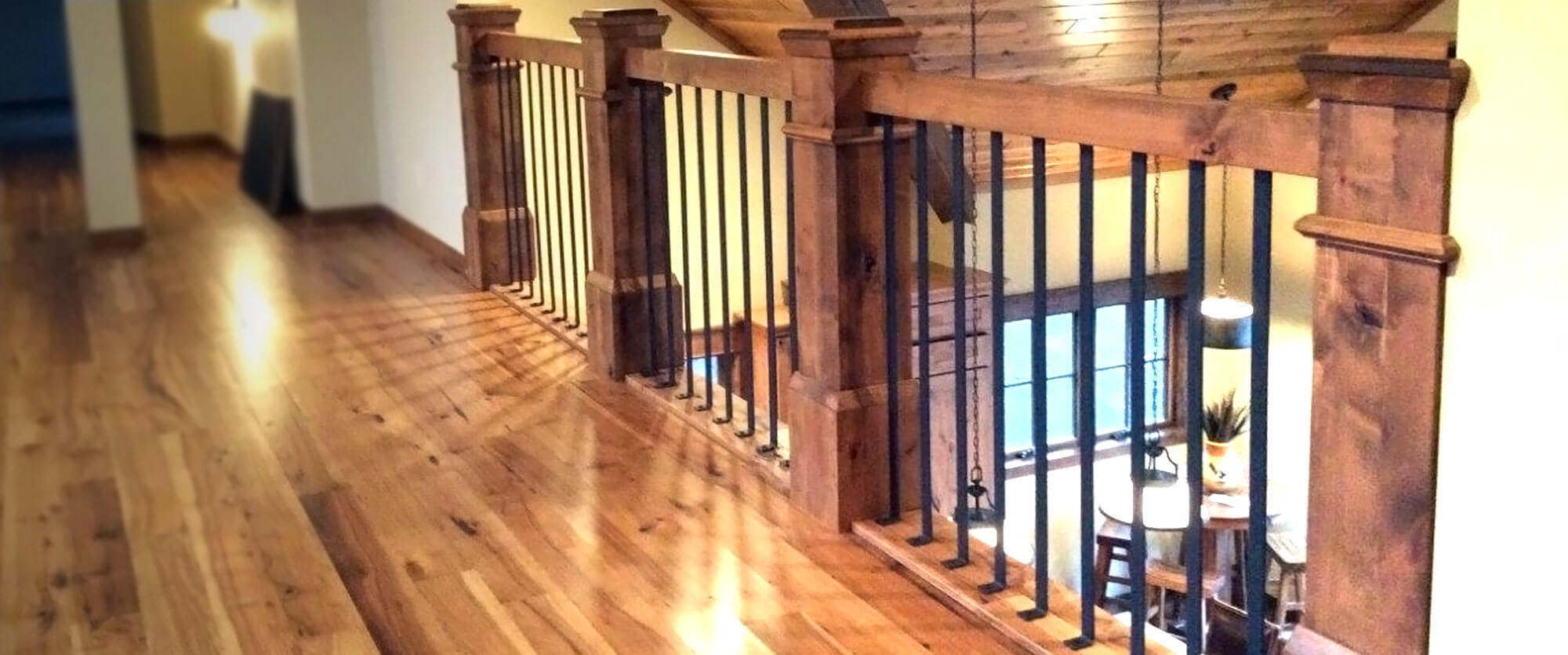 Custom solid wood stair railings; designed, built, and installed by finewood Structures of Browerville, MN