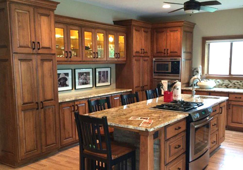 Gourmet kitchen featuring solid wood cabinets made from Alder by finewood Structures of Browerville, MN