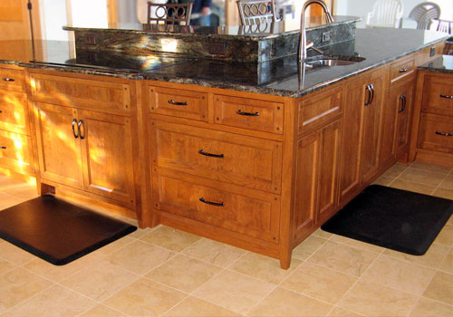 Oversized kitchen island featuring multiple tiers made of solid Cherry wood by finewood Structures of Browerville, MN
